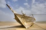 Abandoned Dhow on Beach; Ras Al Hadd, Oman Fotografisk trykk av  Design Pics Inc