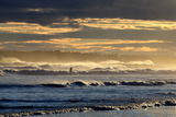A Surfer Rides a Winter Wave Off the Coast of Maine Stampa fotografica di Robbie George