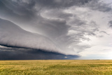 A Supercell Thunderstorm Produces a Spectacular Shelf Cloud over Cropland Photographic Print by Jim Reed