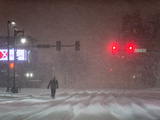 A Man Walking to Work Waits for a Red Light During a Predawn Snowstorm Photographic Print by Jim Reed