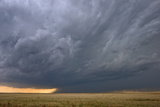 A Supercell Thunderstorm Rotates over a Vacant Field Photographic Print by Jim Reed