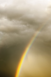 A Vivid Rainbow in a Cloud-Filled Sky Photographic Print by Jim Reed