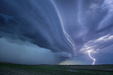 A Supercell Thunderstorm Produces Cloud-To-Ground Lightning During Twilight Photographic Print by Jim Reed