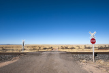 A Deserted Road Leads over a Railroad Crossing and into a Field Photographic Print by Jim Reed