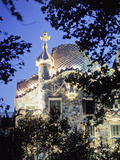 Exterior of Casa Batllo at Dusk with Trees Photographic Print by  Design Pics Inc