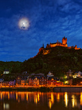 An Atmospheric Corona Circles the Moon Above the Imperial Castle of Cochem Fotografisk tryk af Babak Tafreshi