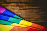 Gay Pride Flag on Wooden Table Photographic Print by  WavebreakMediaMicro