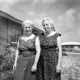 Sisters Pose in the Yard of a Suburban Cleveland Home, Ca. 1966. Photographic Print by Kirn Vintage Stock