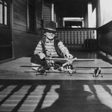 Young Boy with His Model Airplanes, Ca. 1932. Photographic Print by Kirn Vintage Stock