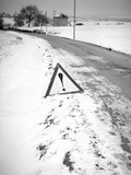 Hazard Road Marker along Snowy Road in Europe, Ca. 1935. Photographic Print by Kirn Vintage Stock