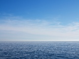 Blue Sky over Calm Sea Fotografie-Druck von Norbert Schaefer