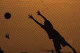 A Boy Jumps for the Ball During a Soccer Game on a Beach in the Capital Luanda Reproduction photographique par Mike Hutchings