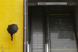 Commuter Walks Past Closed Metro Station Photographic Print by Francois Lenoir