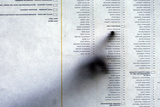 A Bosnian Checks Candidates' Lists before Voting Photographic Print by Damir Sagolj