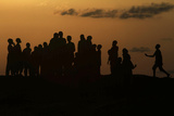 Children Play on Dala Hill at Sunset in the Old City District in Nigeria's Northern State of Kano Lámina fotográfica por Akintunde Akinleye