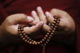 Prayer Beads are Seen as a Tibetan Monk Chants Prayers During Tibetan New Year Celebrations Fotografisk trykk av Navesh Chitrakar