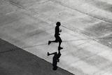 A Pedestrian Crosses an Avenue on a Sunny Day in Mexico City Fotografisk trykk av Tomas Bravo