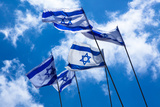 Israeli Flags in the Sky Photographic Print by  EvanTravels