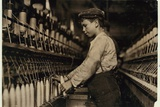A Doffer Replaces Full Bobbins at Globe Cotton Mill, Augusta, Georgia, 1909 Photographic Print by Lewis Wickes Hine