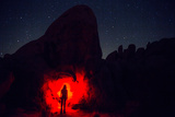 A Hiker with a Red Headlight Makes for an Eerie Photo in Joshua Tree National Park Photographic Print by Ben Horton
