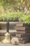 Book, Bell, and Globe Outdoors Fotografie-Druck von Elizabeth Urqhurt