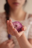Young Woman Holding a Small Pink Flower Photographic Print by Carolina Hernandez