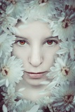 Close Up of Young Girls Face in Flowers Photographic Print by Carolina Hernandez