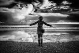 Young Girl Standing on a Beach Impressão fotográfica por Rory Garforth