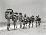 Women Holding Giant Masks Metal Print by  Bettmann