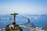 Aerial View of Christ the Redeemer Statue over Looking Rio De Janeiro Located Fotografisk tryk af Mike Theiss
