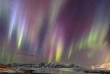 Aurora Borealis Above a Fjord in Western Iceland Fotografisk tryk af Babak Tafreshi