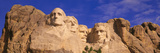 This Is a Close Up View of Mount Rushmore National Monument Against a Blue Sky Photographic Print