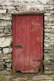 A Red Door in a Stone House in County Kerry, Ireland Photographic Print by Jeff Mauritzen