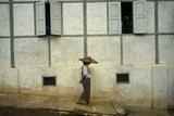 A Woman Walks Past a Meditation Center Reproduction photographique par Tino Soriano