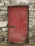 A Red Door in a Stone House in County Kerry, Ireland Metal Print by Jeff Mauritzen