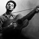 Musician Woody Guthrie (1912-1967) Considered as the Father of Folk Music C. 1940 Photographie