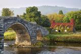 Tu Hwnt I'R Bont Tearoom and Pont Fawr (Big Bridge) in Autumn, Llanrwst, Snowdonia, Conwy, Wales Photographic Print by Stuart Black