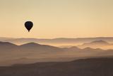 Single Hot Air Balloon over a Misty Dawn Sky, Cappadocia, Anatolia, Turkey, Asia Minor, Eurasia Photographic Print by David Clapp