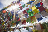 The Tibetan Prayer Flags Made of Colored Cloth Photographic Print by Roberto Moiola