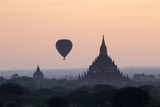 Hot Air Balloon over Temples on a Misty Morning at Dawn, Bagan (Pagan), Myanmar (Burma) Photographic Print by Stephen Studd