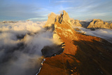 Aerial Shot from Seceda of Odle Surrounded by Clouds at Sunset in the Dolomites Photographic Print by Roberto Moiola