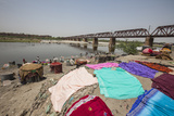 Colorful Clothes Drying in the Sun on the Banks of the River Yamuna Photographic Print by Roberto Moiola