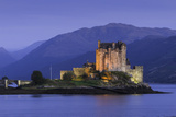 Eilean Donan Castle Floodlit at Night on Loch Duich, Scotland, United Kingdom Reproduction photographique par John Woodworth