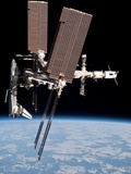 Space Shuttle Endeavor Docked to the International Space Station Metal Print