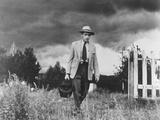 Country Doctor Ernest Ceriani Making House Call on Foot in Small Town Metalltrykk av W. Eugene Smith