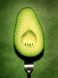 Half an Avocado with a Fork Metal Print by Tina Chang