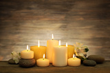 Beautiful Composition with Candles and Spa Stones on Wooden Background Fotografisk trykk av  Yastremska