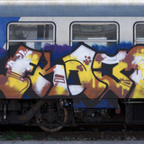 Grafitti on Train Carriage, Pisa, Italy Photographic Print by Mike Burton