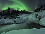 A Wintery Waterfall And Aurora Borealis Over Tennevik River, Norway Metalltrykk av Stocktrek Images