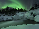 A Wintery Waterfall And Aurora Borealis Over Tennevik River, Norway Metalldrucke von Stocktrek Images